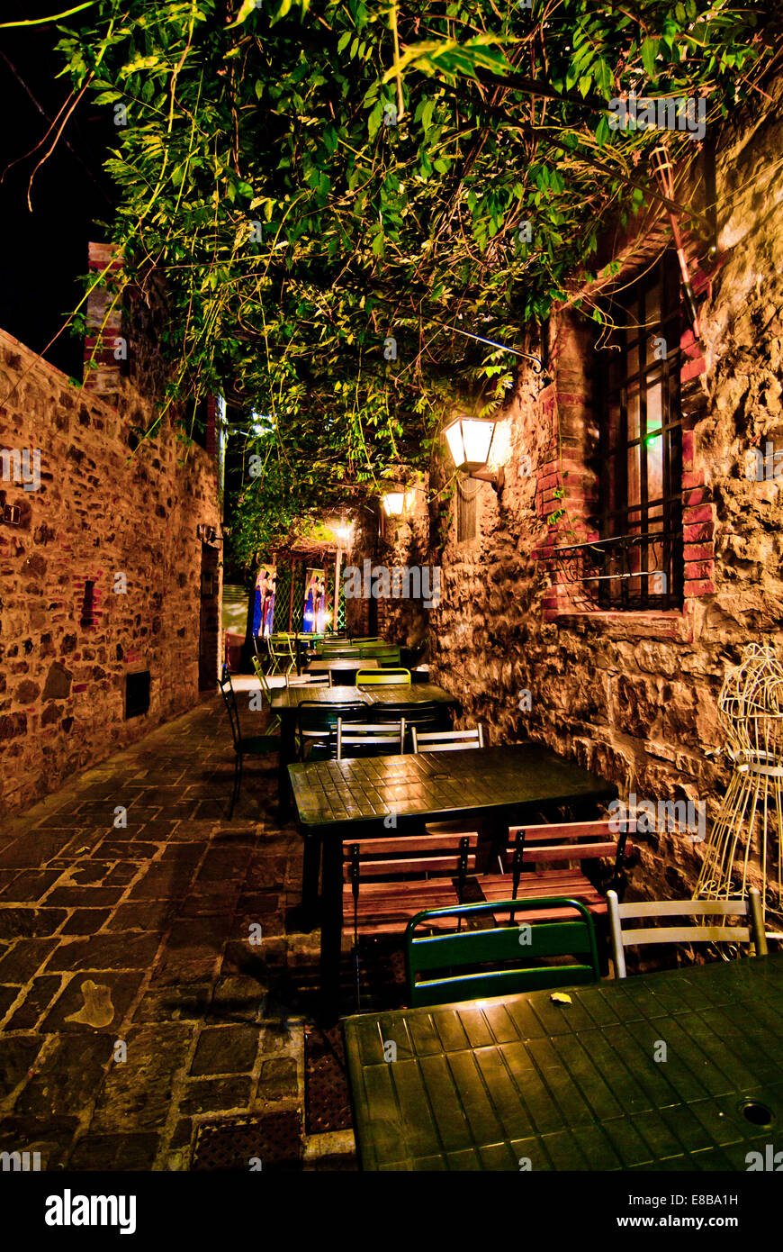romantic dinner at night in a small Italian restaurant with outdoor ...