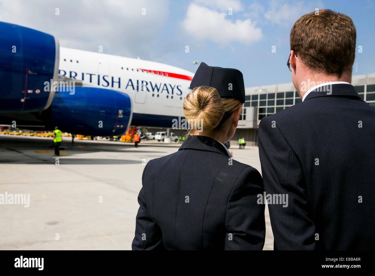 Dulles International Airport, Virginia, USA. 2nd October, 2014. British Airways cabin crew members greet a BA Airbus - Stock Image