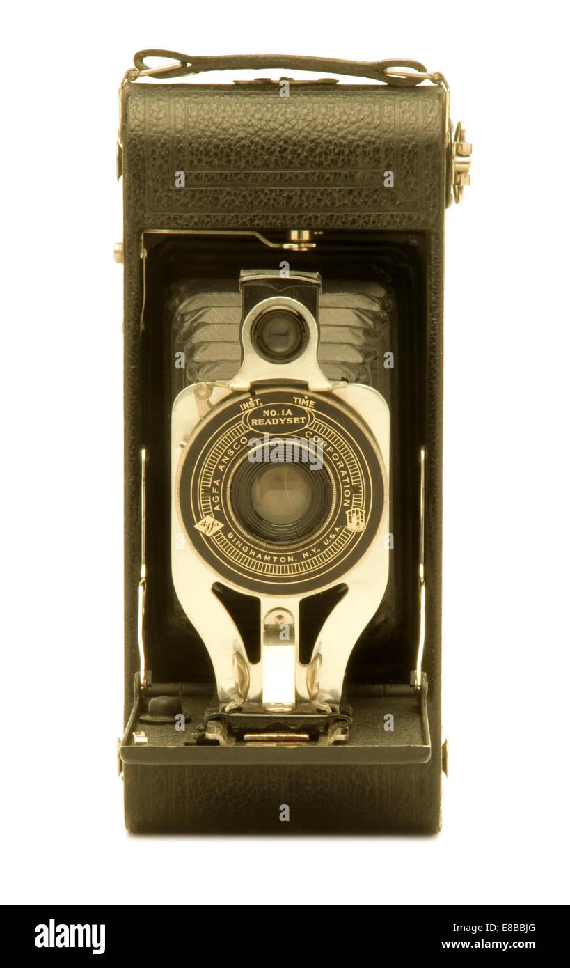 Vintage Agfa Ansco folding bellows film camera against white background. - Stock Image