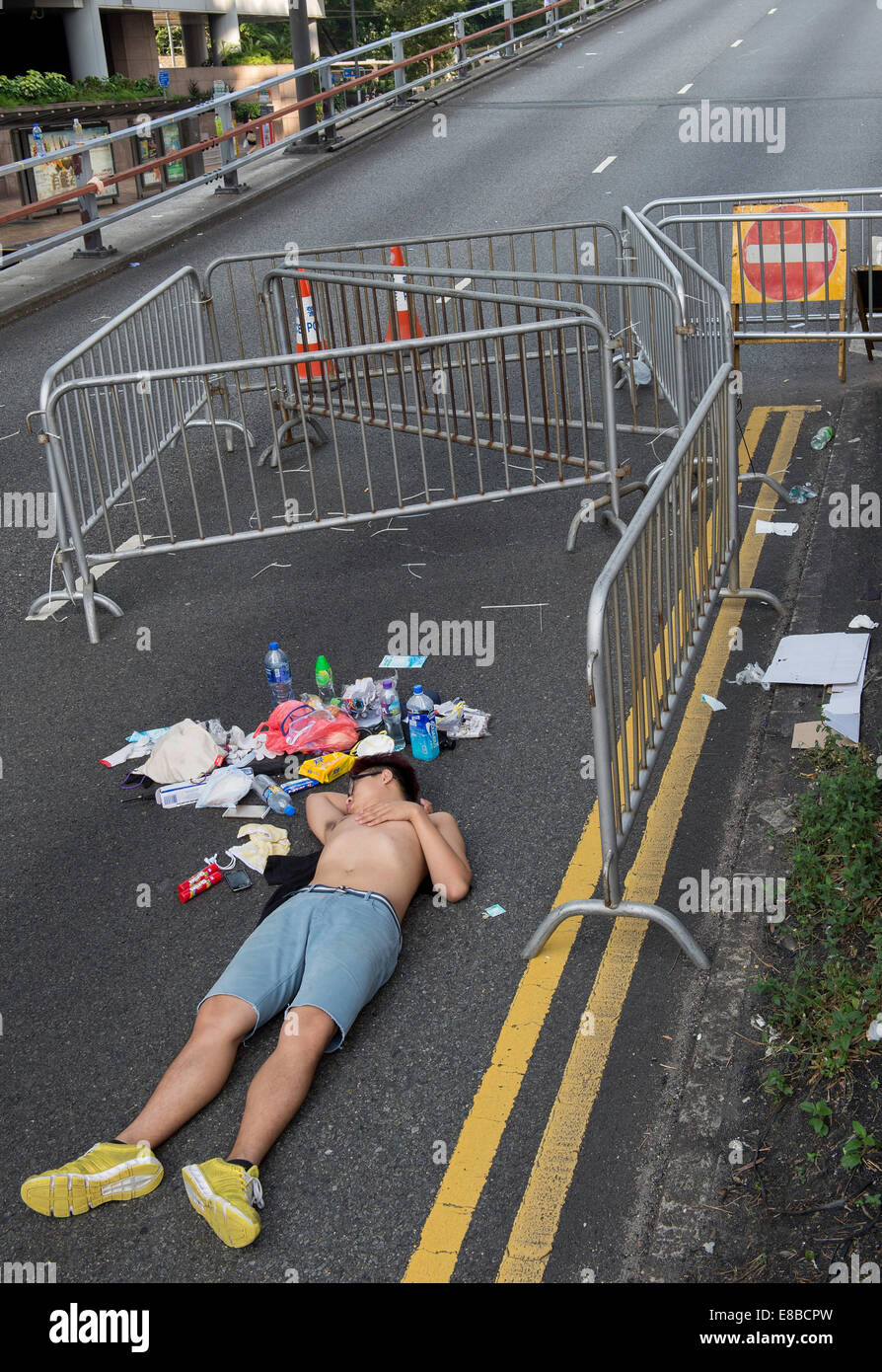 Student protester sleeps it off on the road Cotton Tree Drive Admiralty - Stock Image