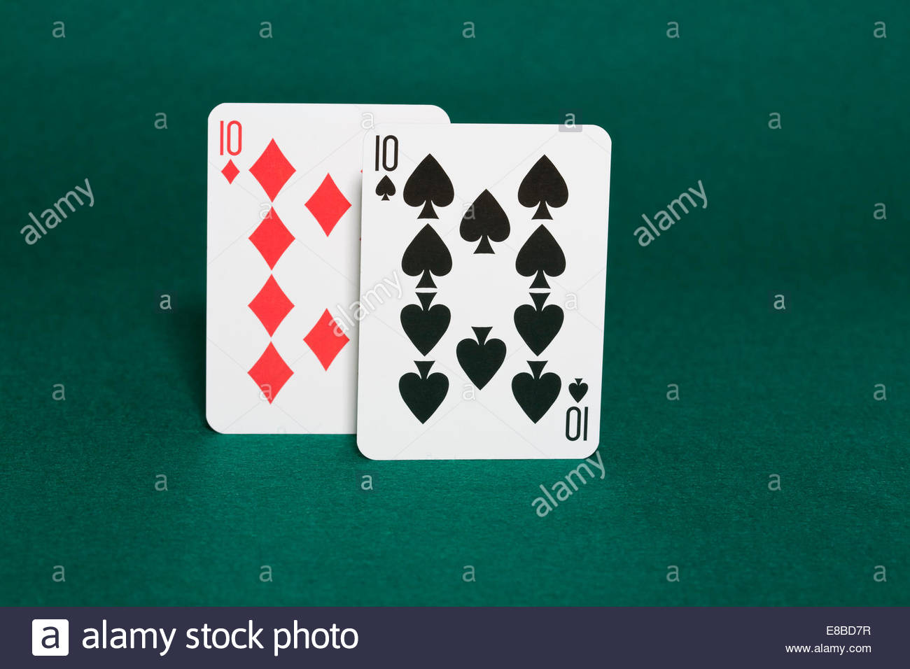 Closeup of pocket tens starting hand in hold'em poker also called dimes in horizontal view - Stock Image