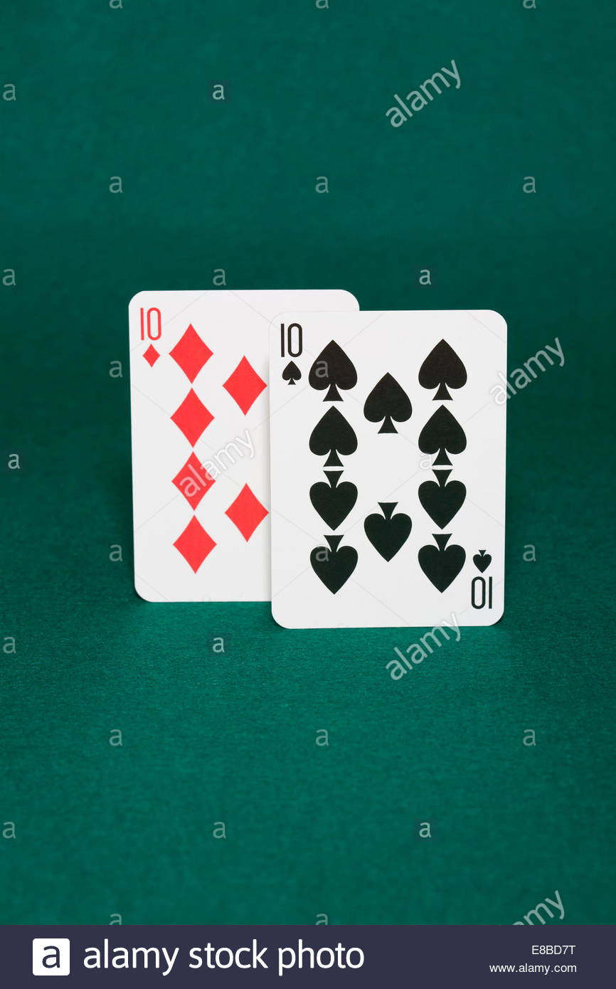 Closeup of pocket tens starting hand in hold'em poker also called dimes - Stock Image