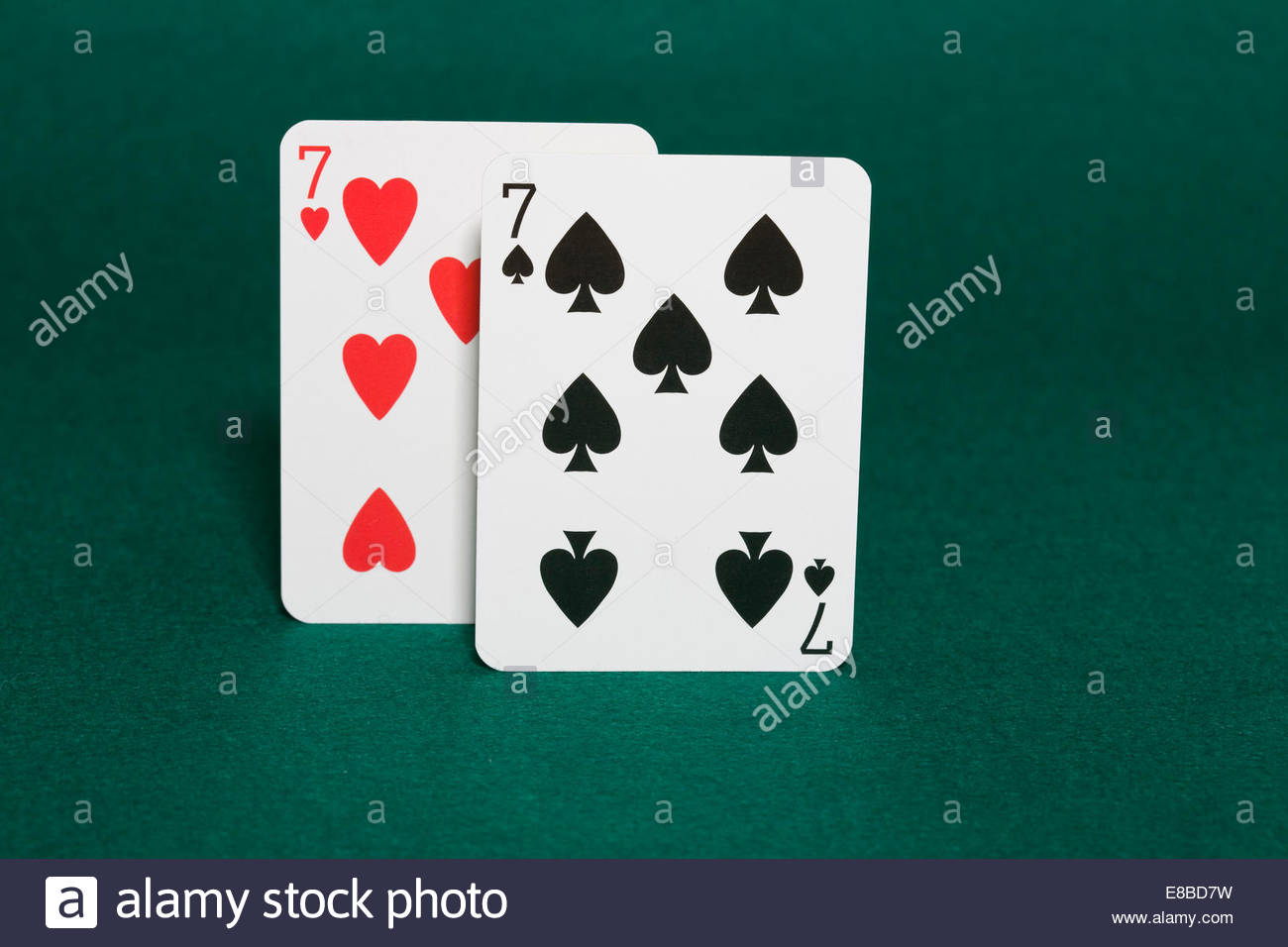 Closeup of pocket sevens starting hands in hold'em poker also called walking sticks in horizonal view - Stock Image