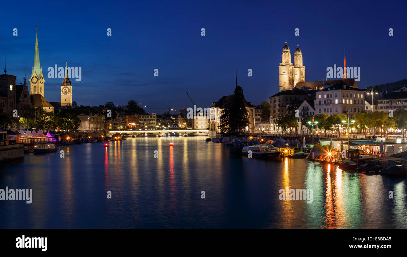 The old town of Zurich at night with the river Limmat, Switzerland Stock Photo