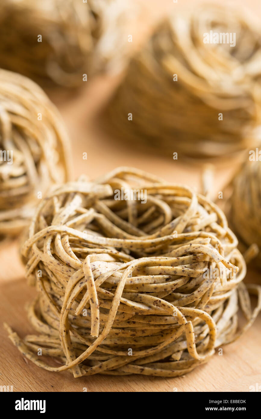 Tajarin or Tagliolini, made with fresh eggs and buckwheat flour, a specialty pasta shape from Piemonte, region of - Stock Image