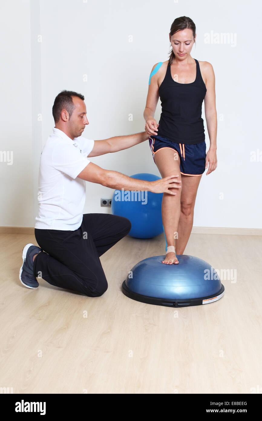 balance training on platform with coach - Stock Image