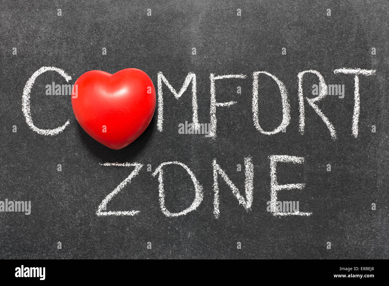 comfort zone phrase handwritten on blackboard with heart symbol instead of O Stock Photo
