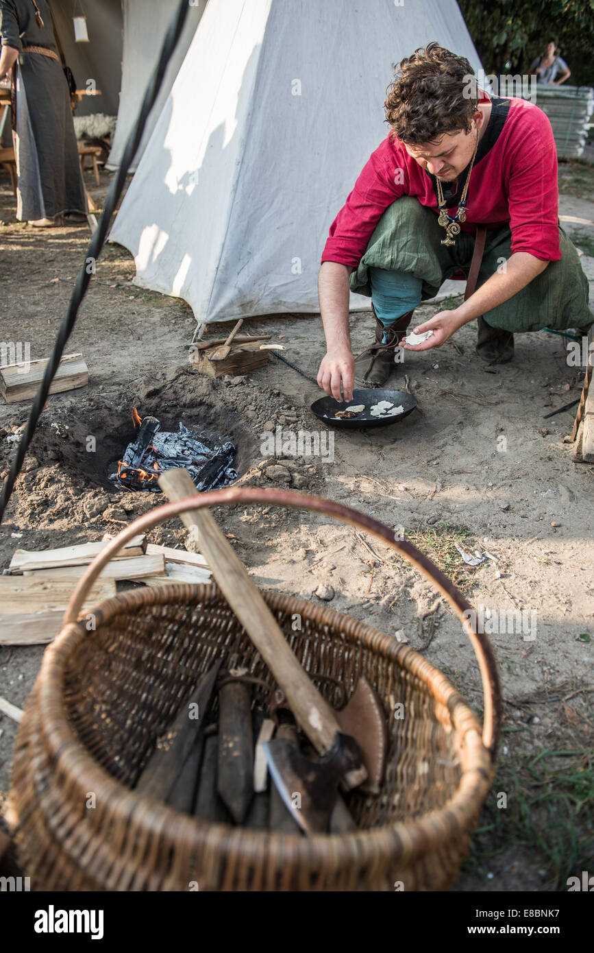 man preparing traditional food in ancient Slavic societies made of flour, water and salt called podplomyk (prural - Stock Image
