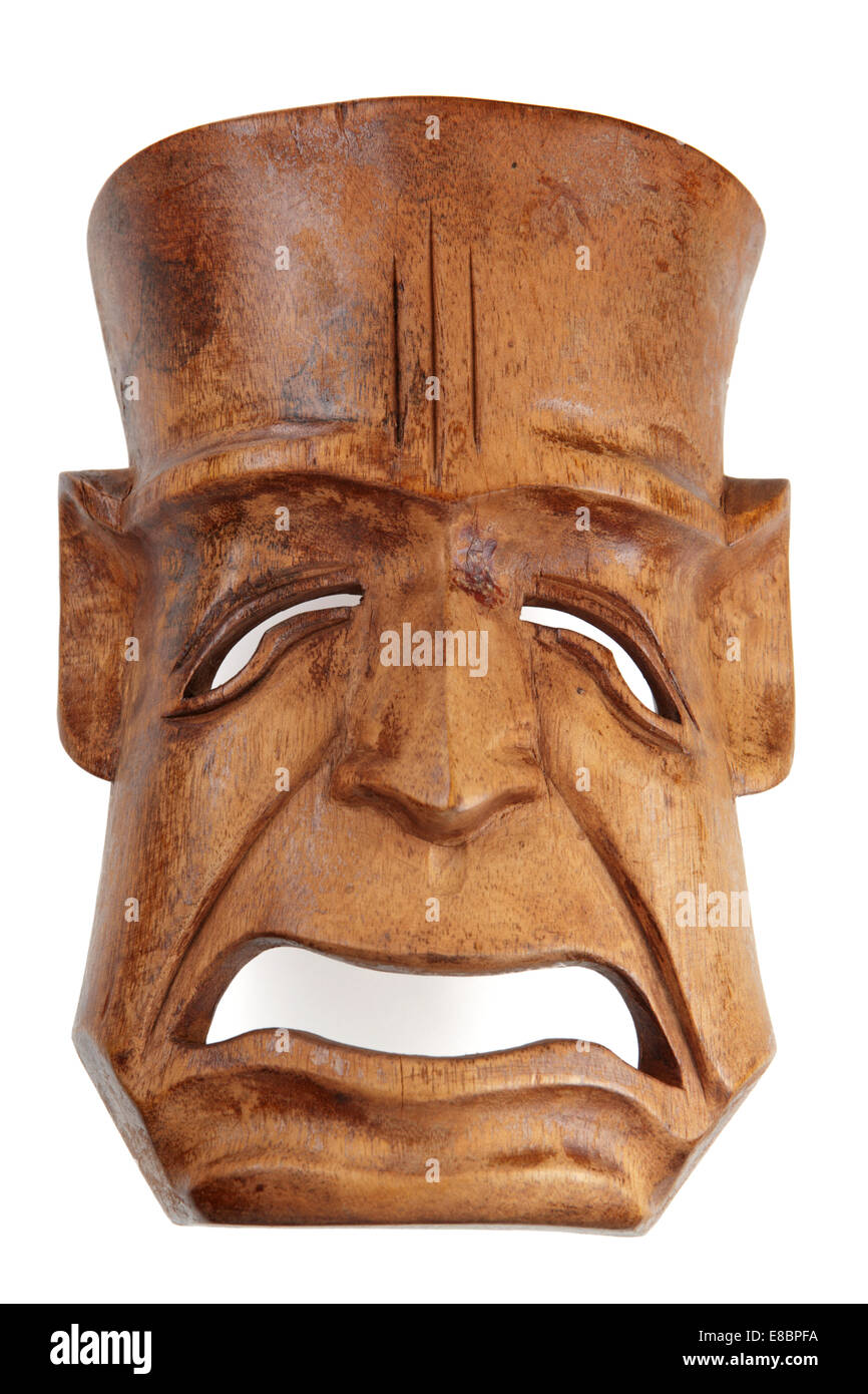 Wood carved tragedy theater mask on white - Stock Image