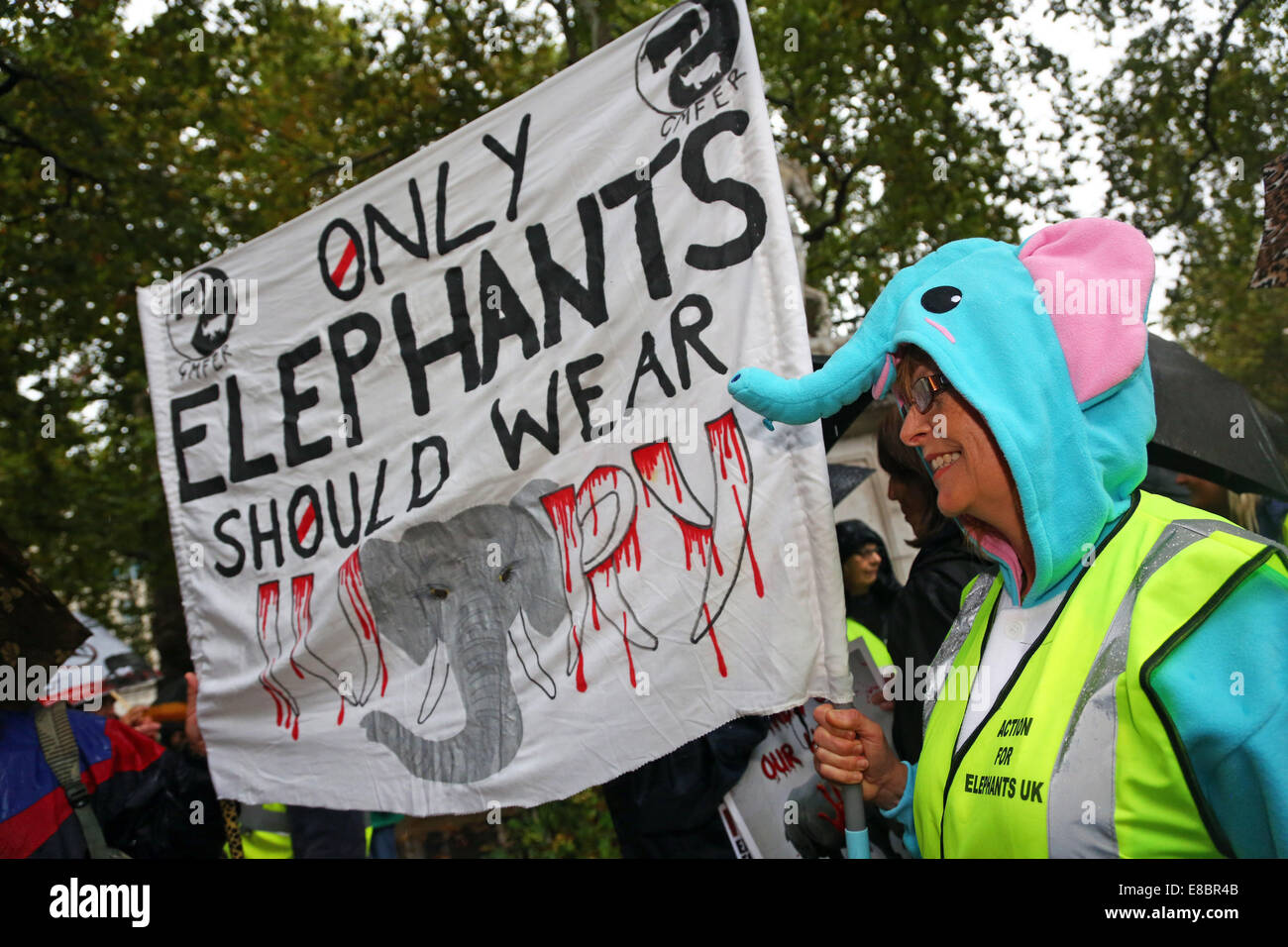 London, UK. 4th October 2014. Marchers with placards and banners at the Global March for Elephants and Rhinos, London, - Stock Image