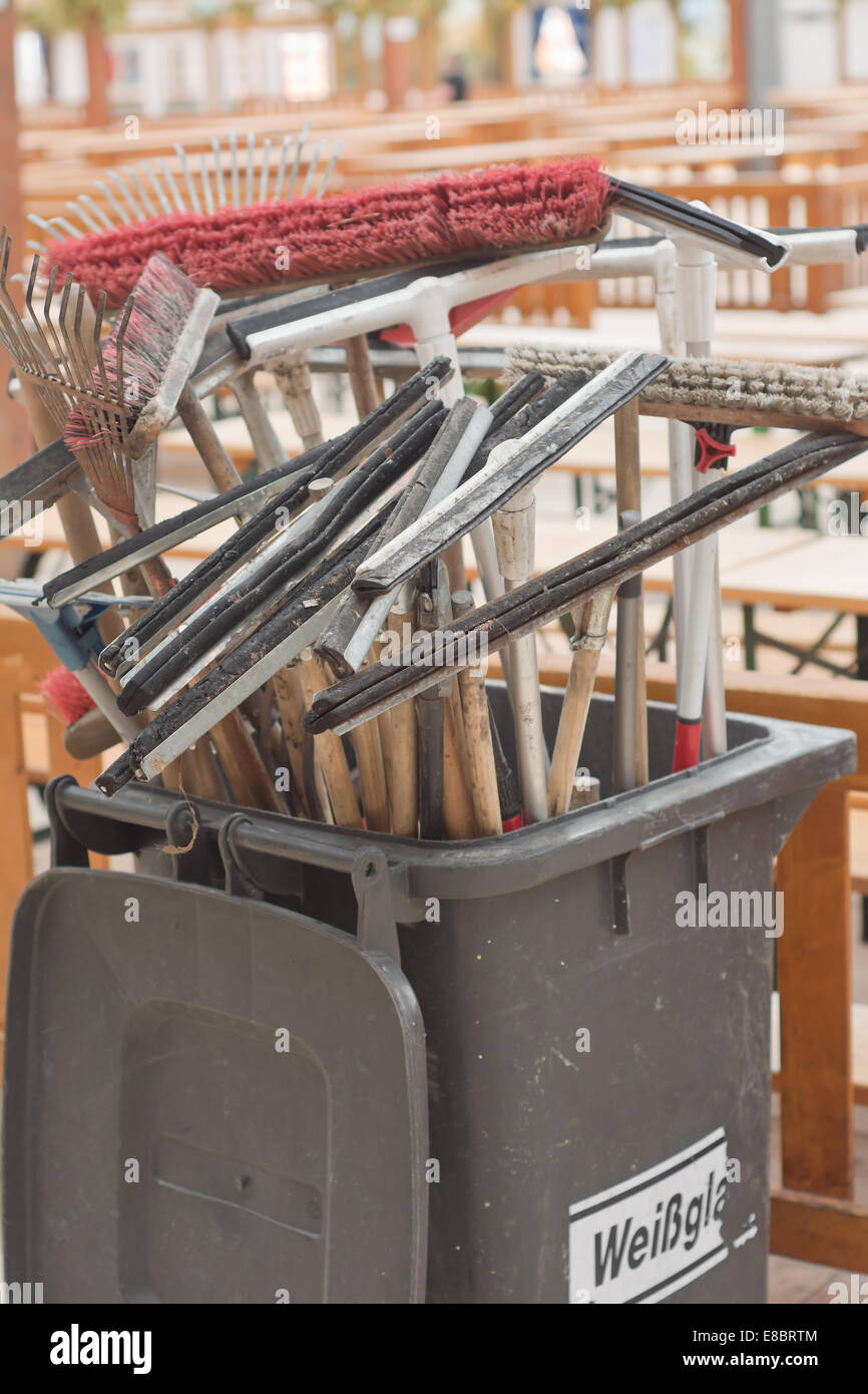 Industrial Cleaning Squeegees  with Trash Can - Stock Image