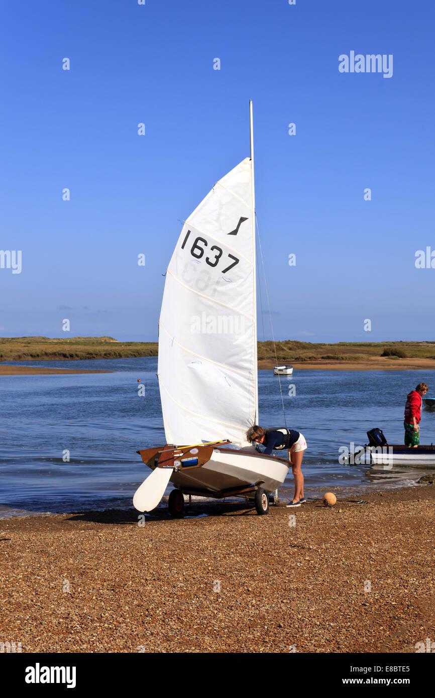 Woman preparing to Sail at Burnham Overy Staithe - Stock Image
