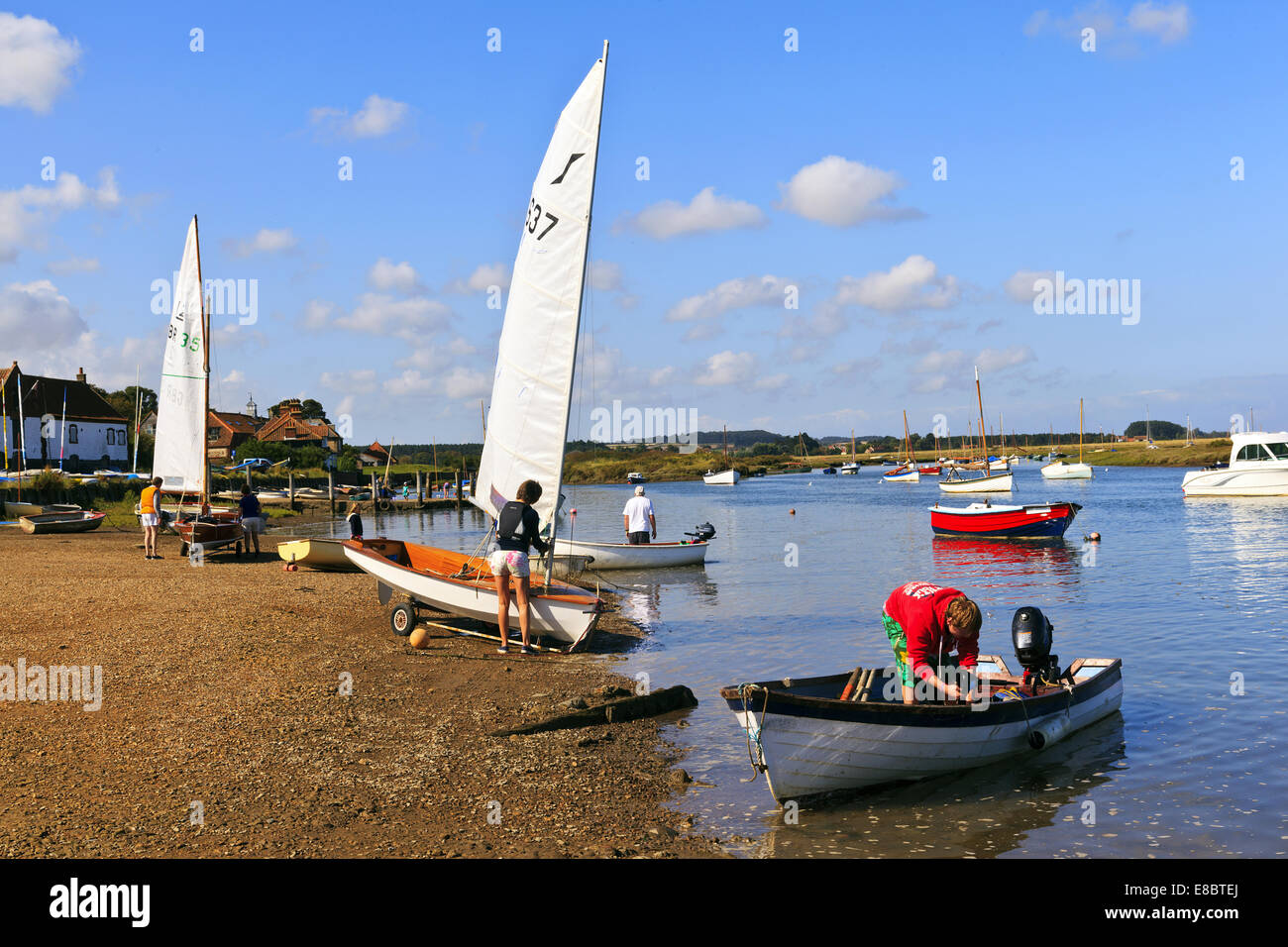 Preparing to Sail on the creek at Burnham Overy Staithe - Stock Image