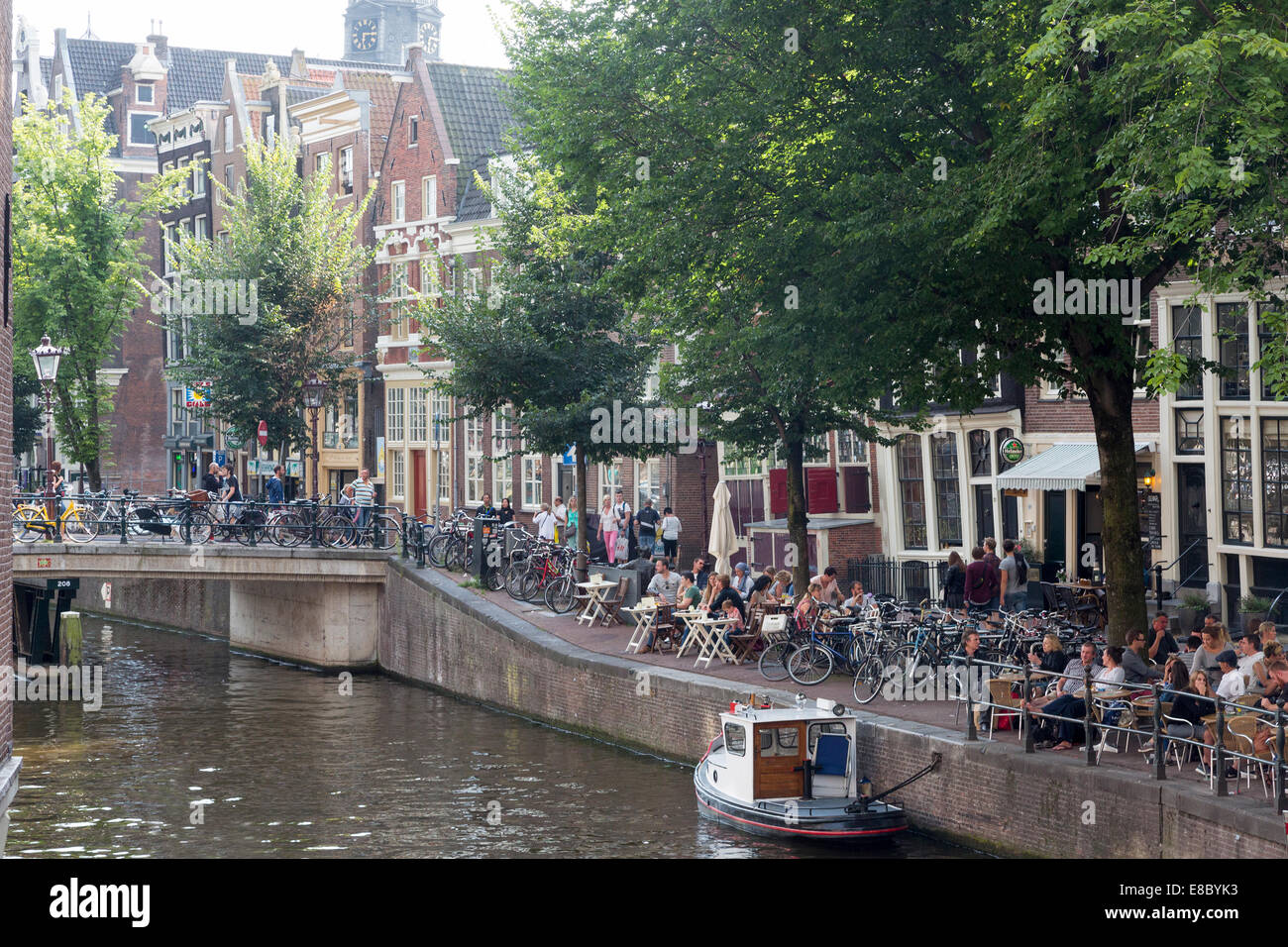 canal side cafes in central Amsterdam, Holland - Stock Image
