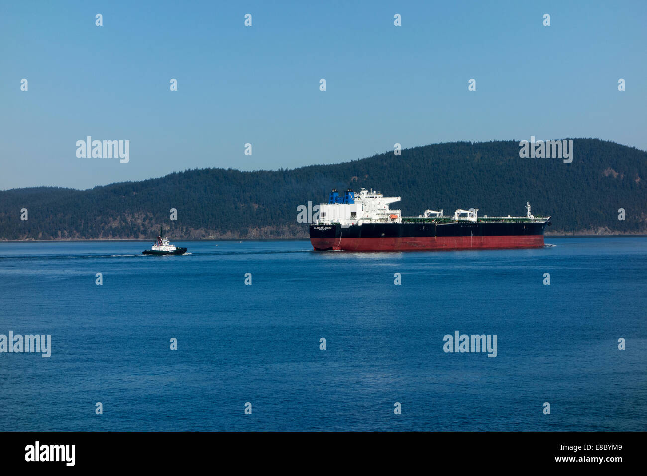 Alaskan Legend crude oil tanker with tugboat, San Juan Islands, Washington State, USA - Stock Image
