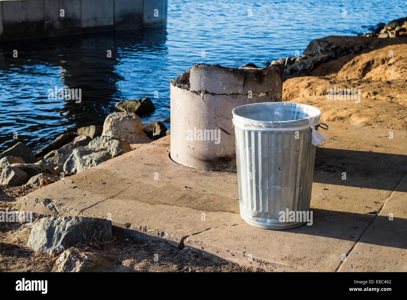 Metal trash can. - Stock Image