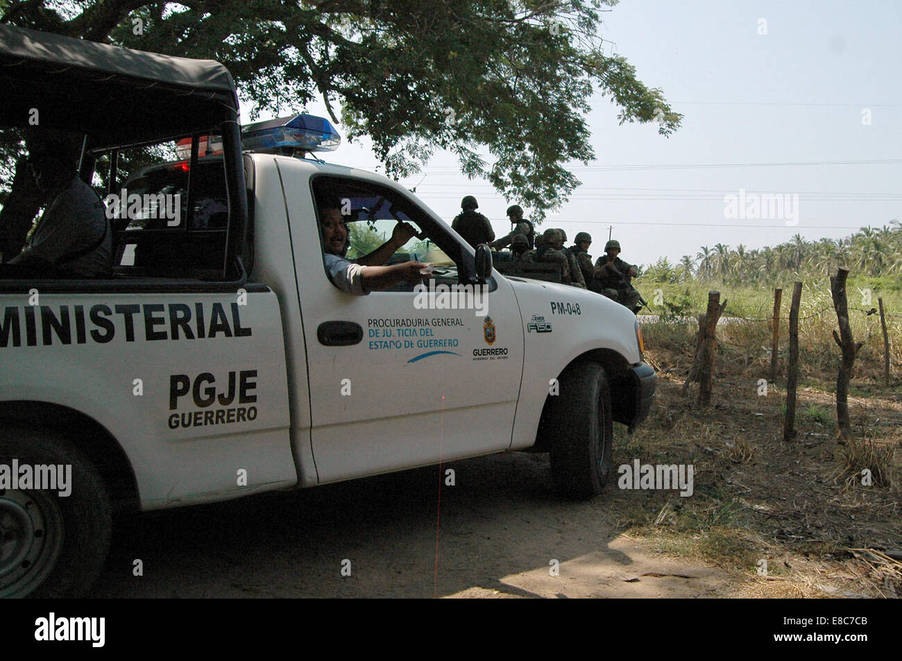 Guerrero, Mexico. 4th Oct, 2014. Security elements stand guard at the site where a grave of human remains was found - Stock Image