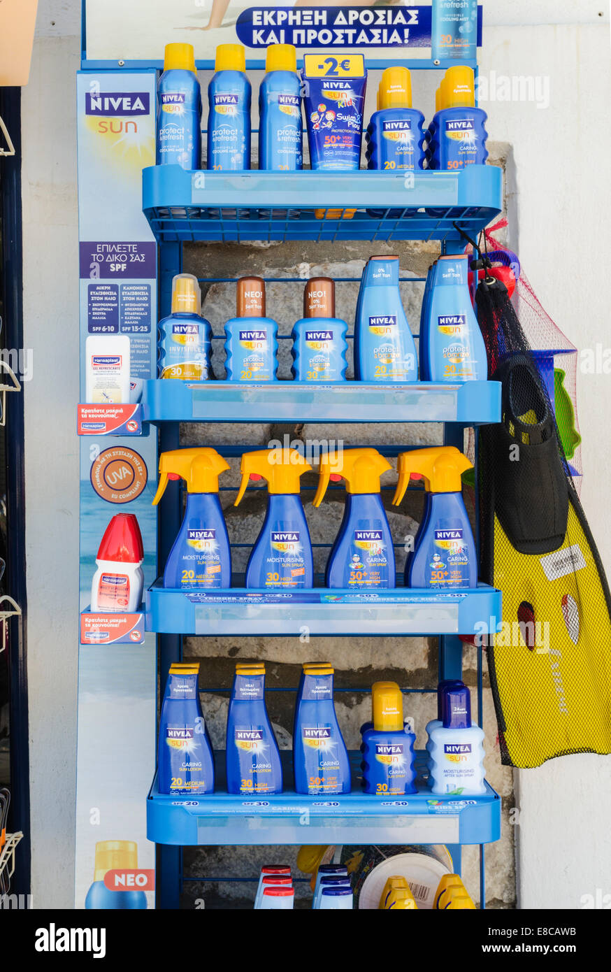 Bottles of Nivea sunscreen on a stand outside a shop in the Greek Islands - Stock Image