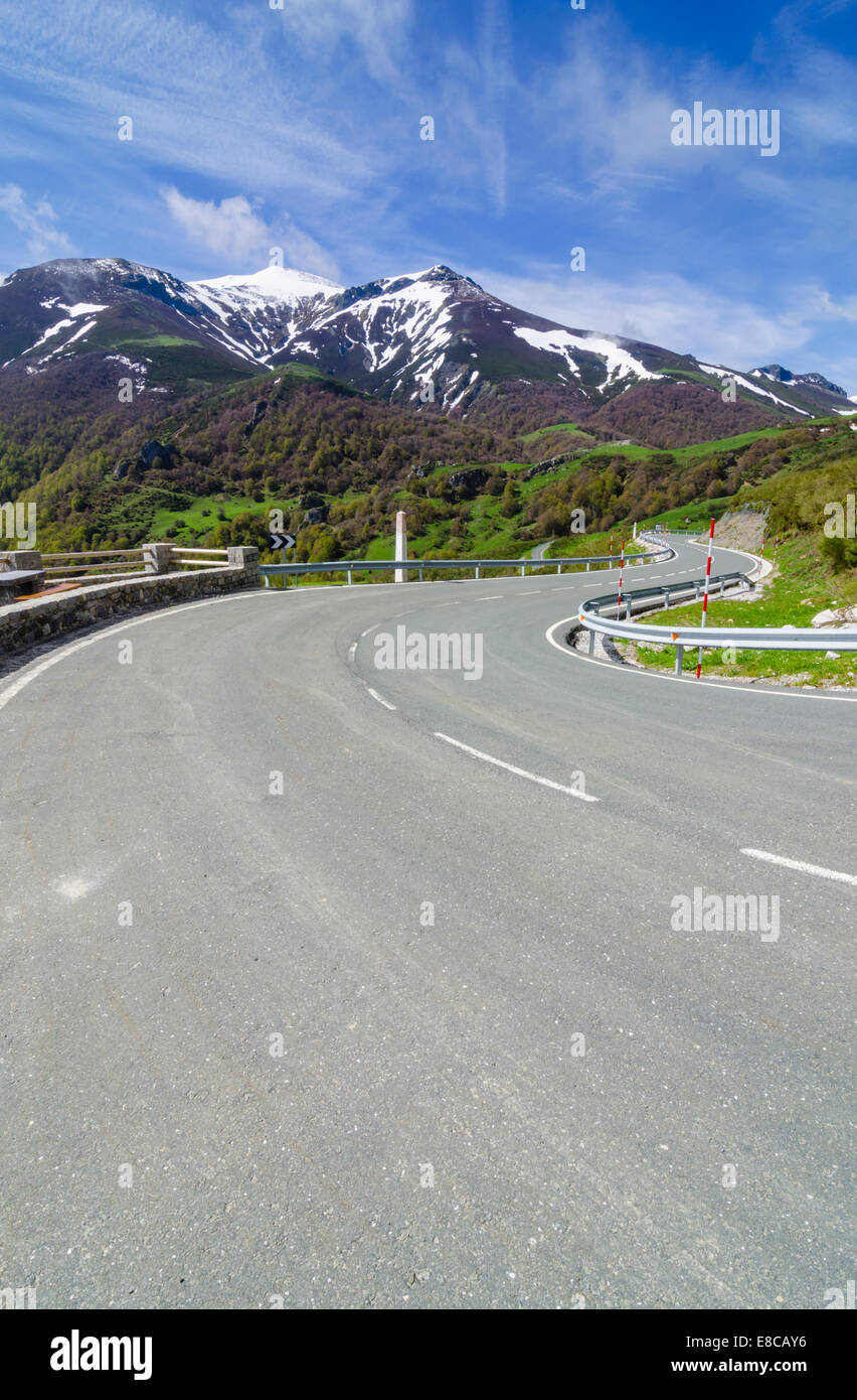 Empty winding road in the mountains of Cantabria, Spain - Stock Image