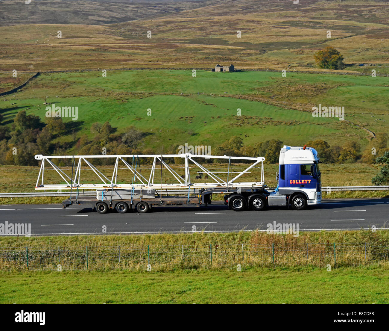 Collett HGV with load of steelwork. M6 Motorway, northbound. Shap, Cumbria, England, United Kingdom, Europe. - Stock Image