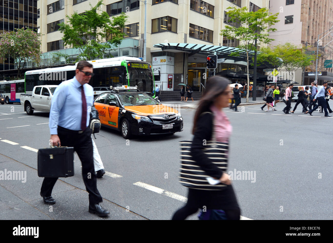 BRISBANE - SEP 24 2014:Business people crossing a road in Brisbane ,Australia.Brisbane has a population of 2,238,394 - Stock Image