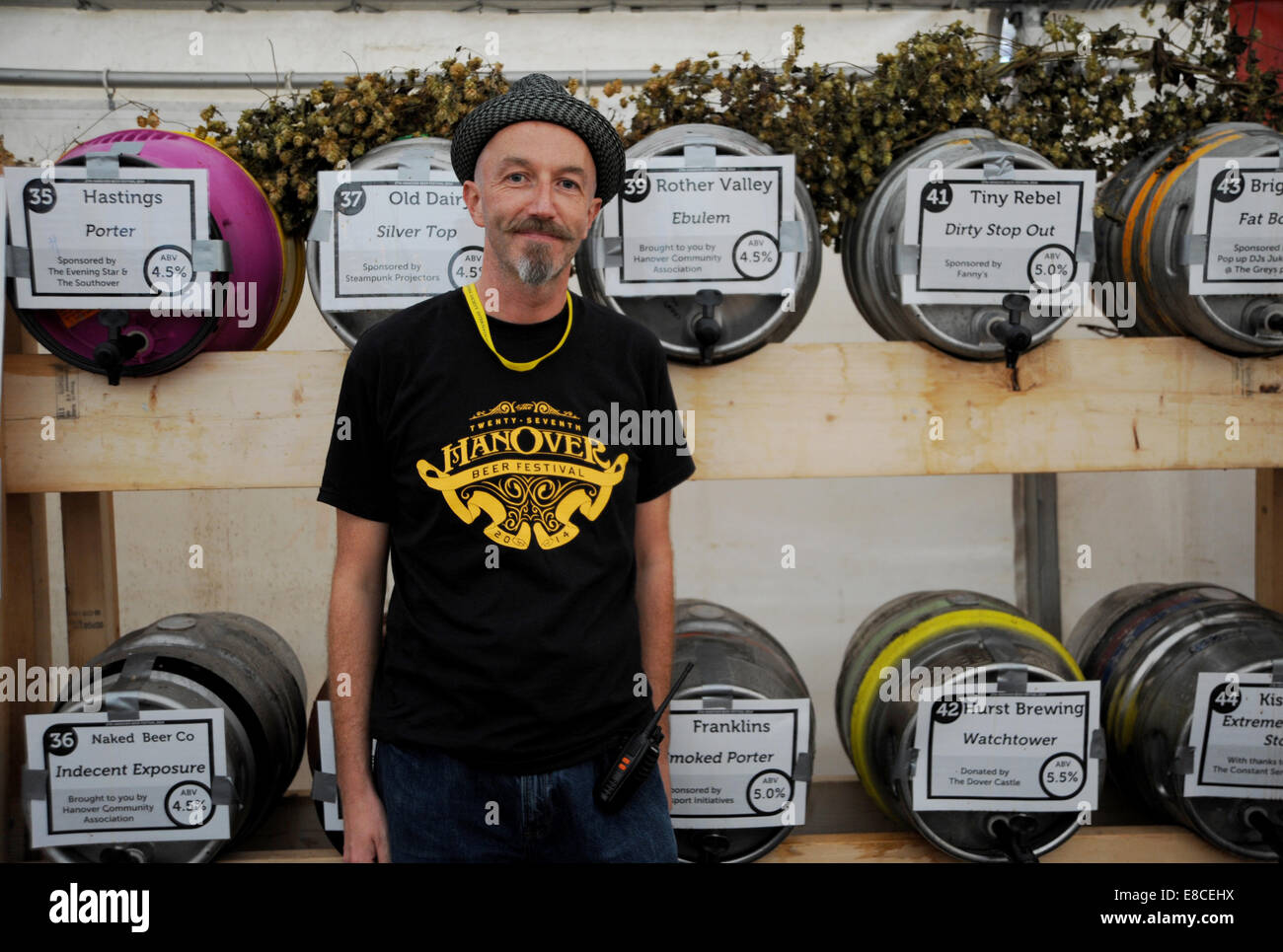 Brighton Sussex UK 3 October 2014  - Jamie Sellers in front of the barrels at the first night of the 27th Hanover - Stock Image