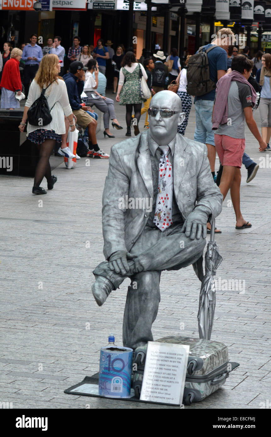 BRISBANE, AUS - SEP 24 2014:An unidentified busking mime performs at Queen Street Mall.It is a pedestrian mall with - Stock Image