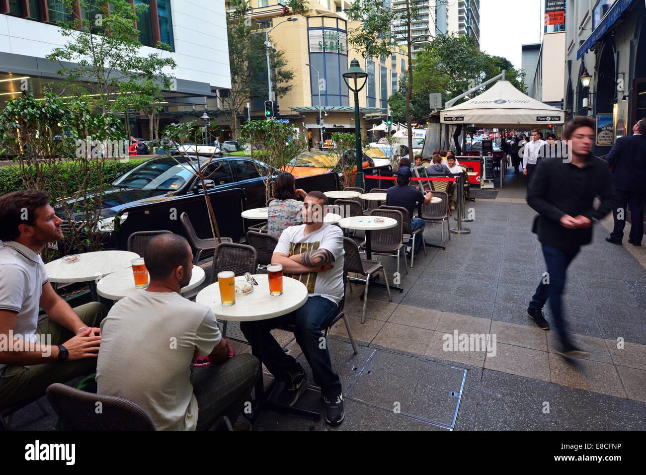 BRISBANE - SEP 24 2014:Young man drinking bear in Brisbane CBD ,Australia.Brisbane has a population of 2,238,394 - Stock Image