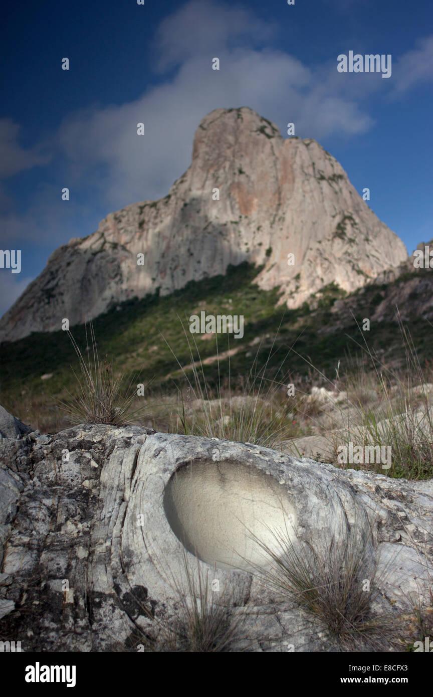 The fossilized imprint of a dinosaur egg is seen near the Pena de Bernal monolithic mountain in San Sebastian Bernal, - Stock Image
