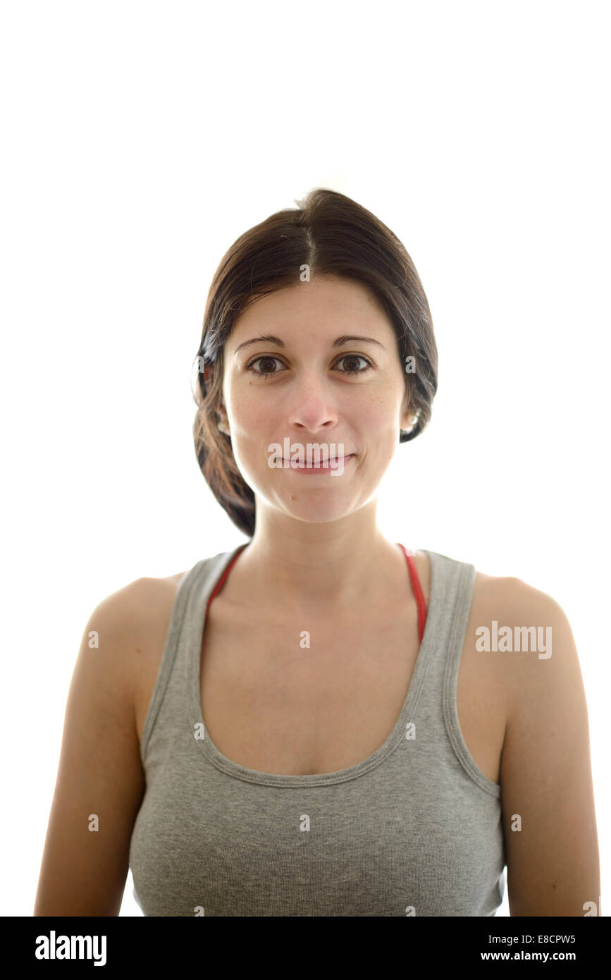 98b620e02a9b4 Portrait of cute young woman in tank top looking at camera - Stock Image