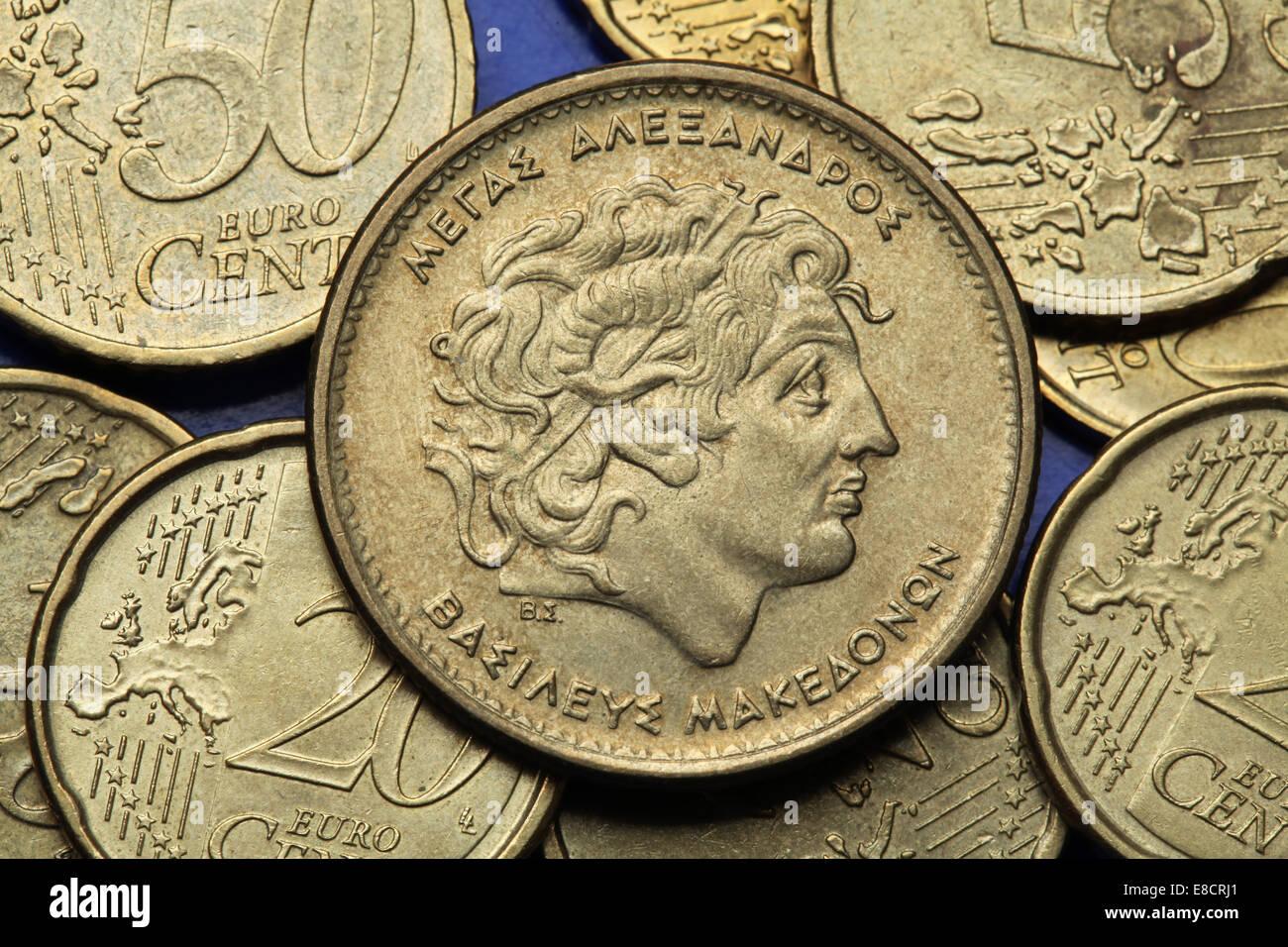 Coins of Greece. Alexander the Great depicted in the old Greek 100 drachma coin. - Stock Image