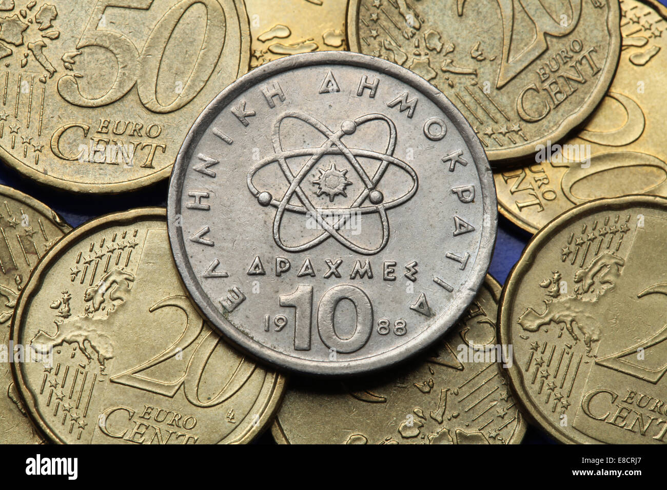 Coins of Greece. Atom, electron and neutron depicted in the old Greek 10 drachma coin. - Stock Image
