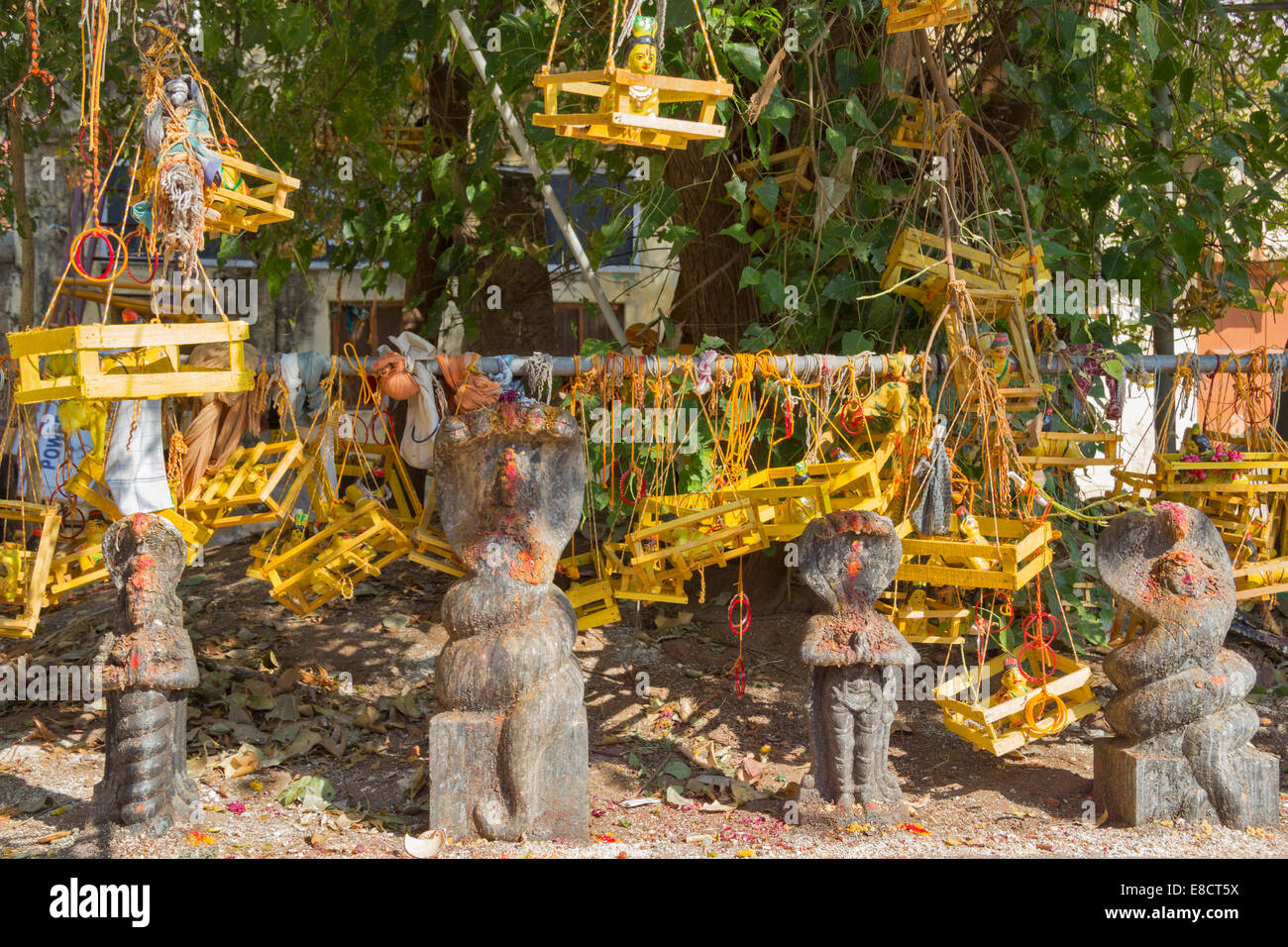 MEENAKSHI AMMAN TEMPLE MADURAI INDIA A SHRINE OF FERTILITY MODEL BABIES CONTAINED IN THE YELLOW CRADLES - Stock Image