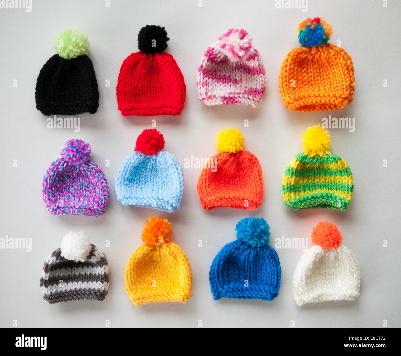 Miniature knitted hats - Stock Image