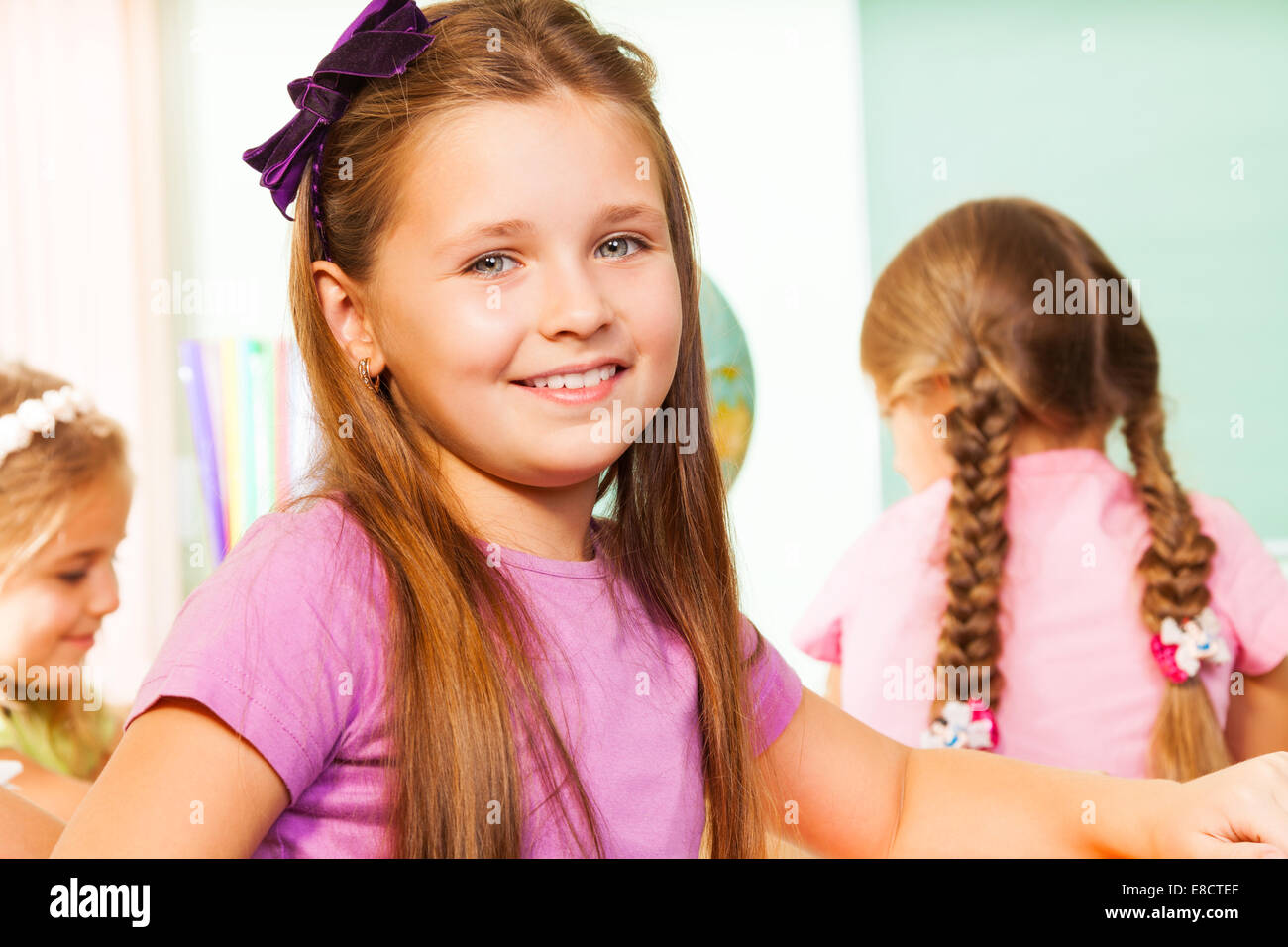 Nice girl close up view looking straight - Stock Image