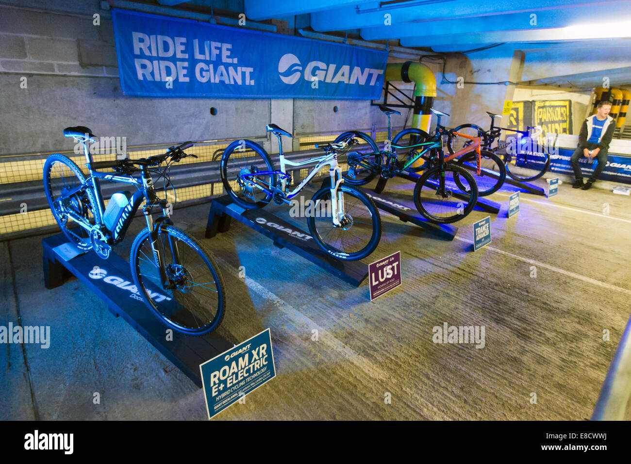 Giant bicycles on display at Parkour Ride a multi-discipline cycling event held in an abandoned multi-storey car - Stock Image