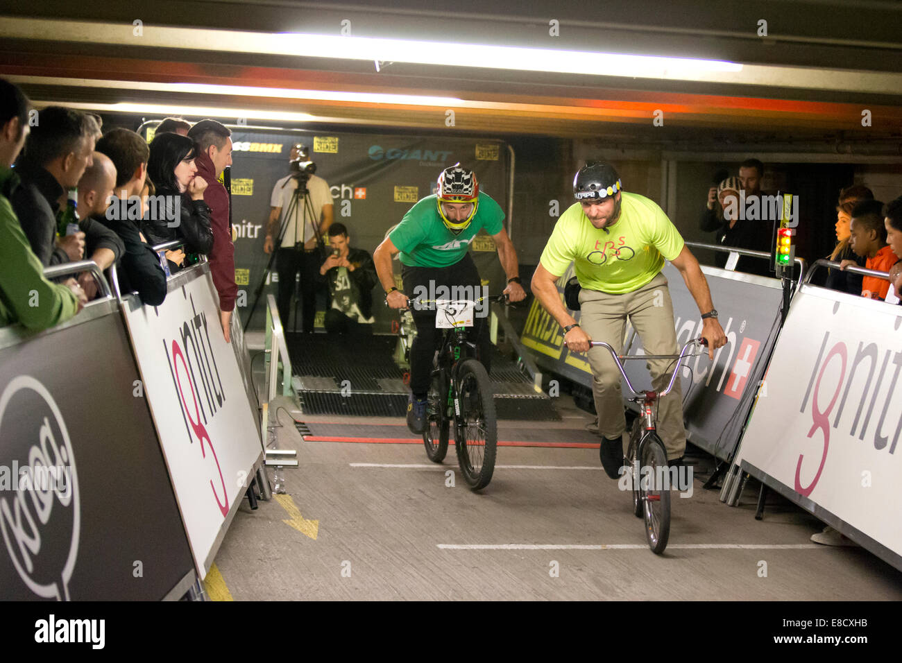 Rob REED & David JAQUIN at Parkour Ride a multi-discipline cycling event held in an abandoned multi-storey car - Stock Image