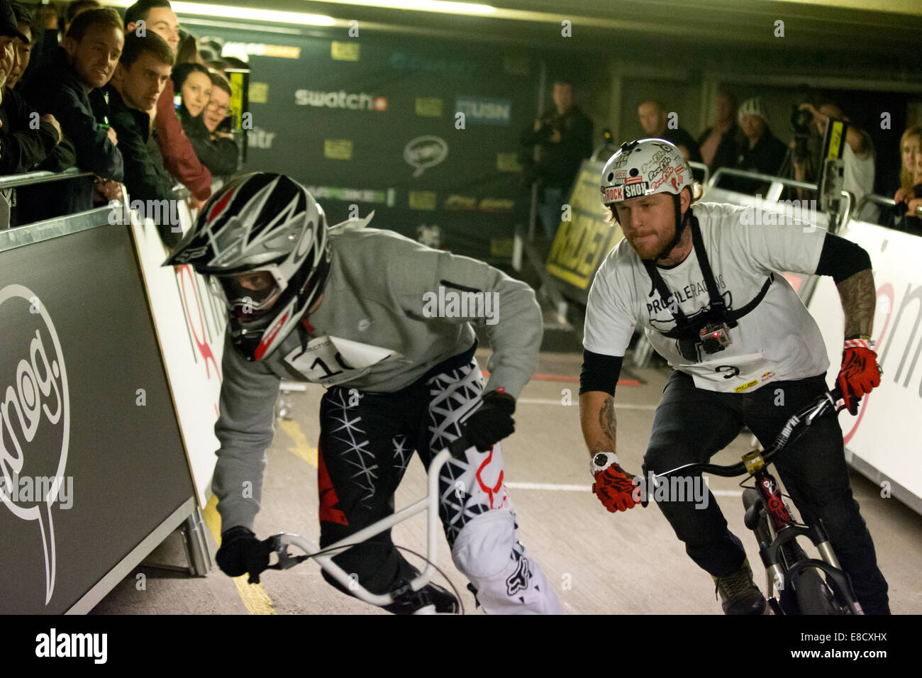 Ricky CROMPTON & Andy WATERMAN at Parkour Ride a multi-discipline cycling event held in an abandoned multi-storey Stock Photo