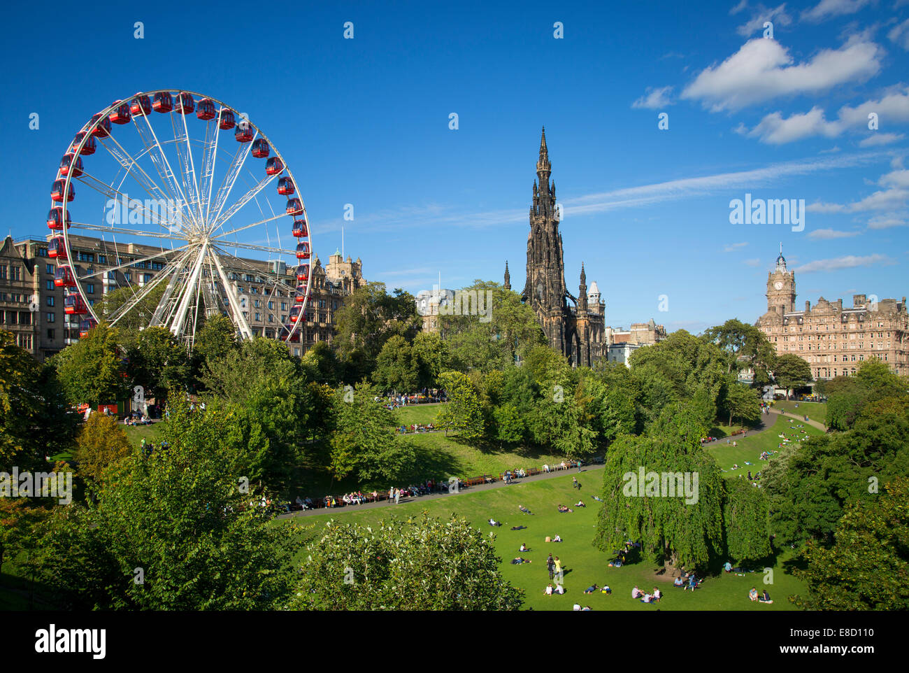 Princes Street Gardens with the Festival Wheel and Sir Walter Scott memorials, Edinburgh, Scotland - Stock Image