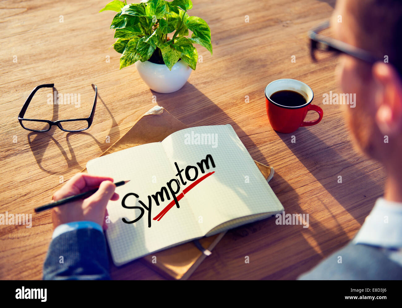 A Man Brainstorming about Symptom Concept - Stock Image