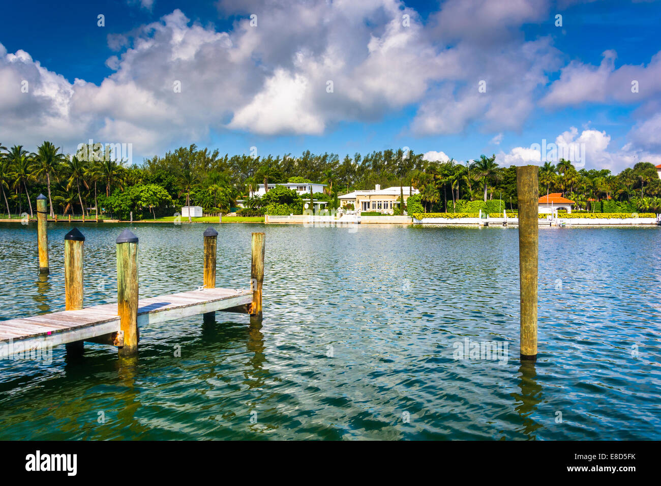 Dock and houses along Collins Canal in Miami Beach, Florida. Stock Photo