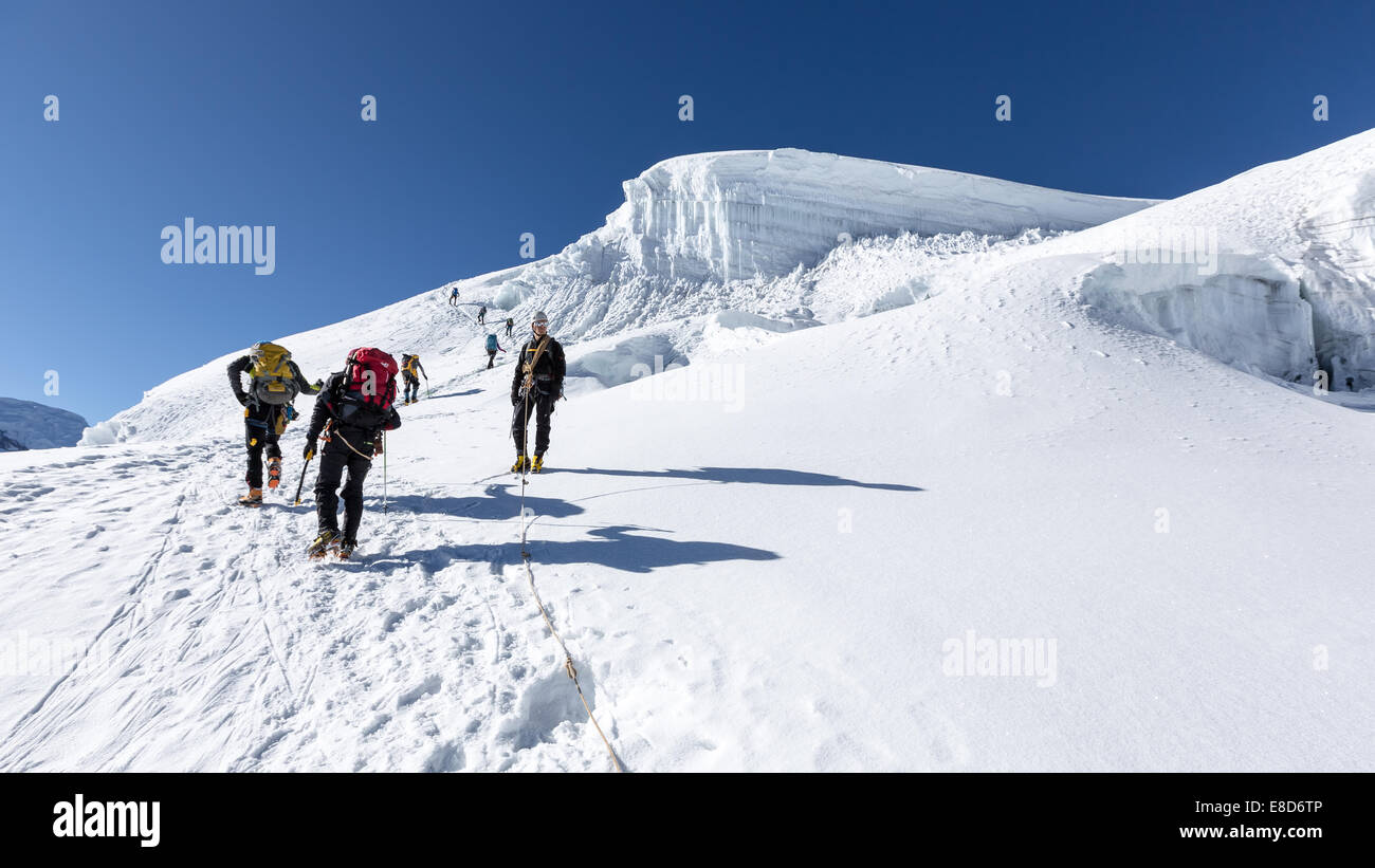 Descending from Ishinca (5530m) with other climbers ascending, Ishinca valley, Cordillera Blanca, Peru, South America - Stock Image