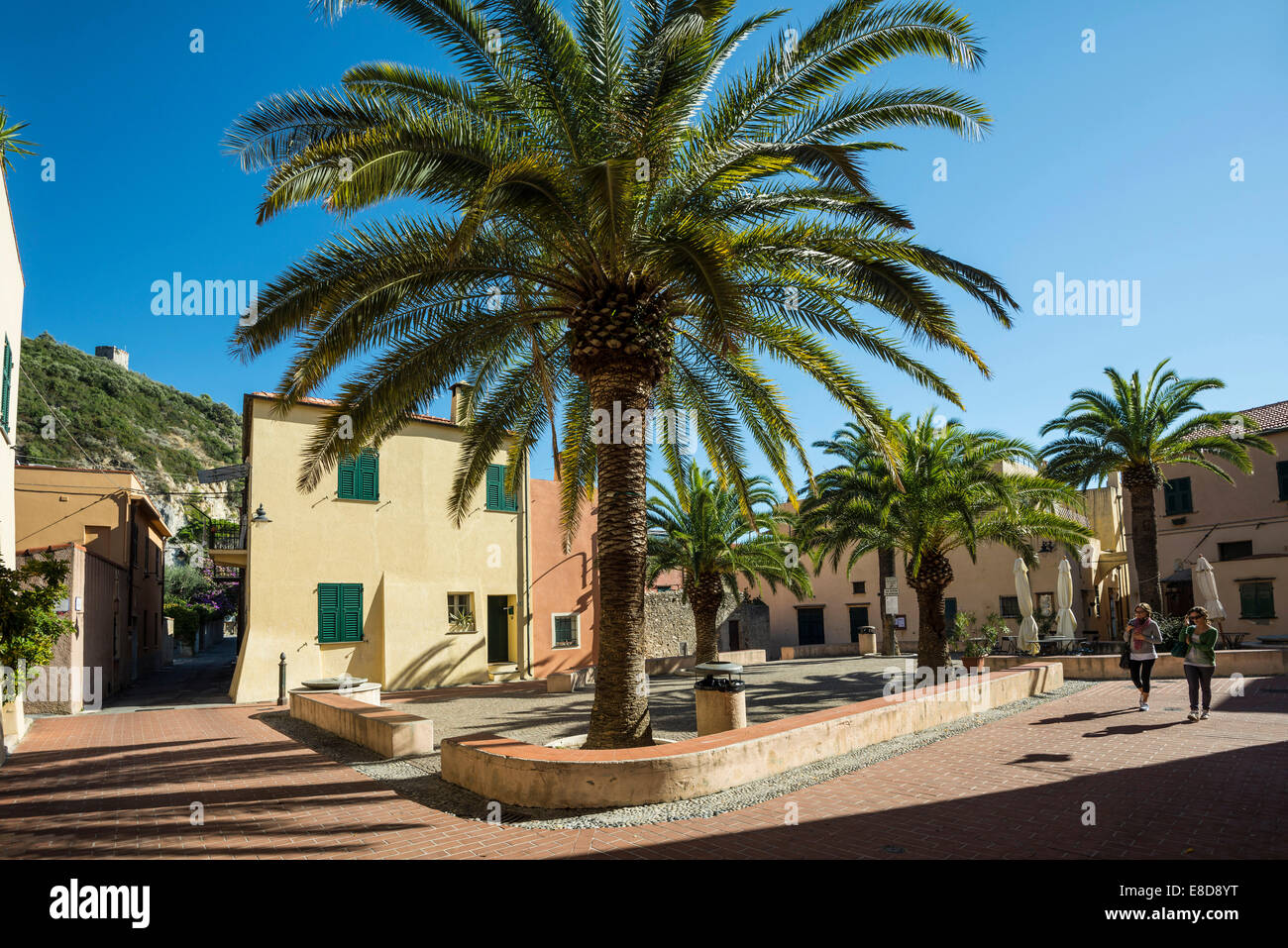 Square with palm trees, Varigotti, Finale Ligure, Liguria, Italy Stock Photo