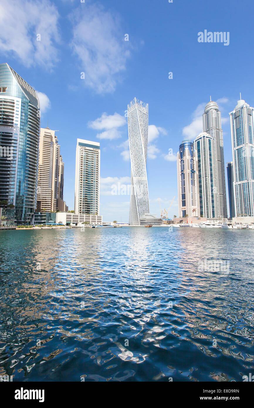 Cayan Tower and skyscrapers with marina, Dubai Marina, Dubai, United Arab Emirates - Stock Image