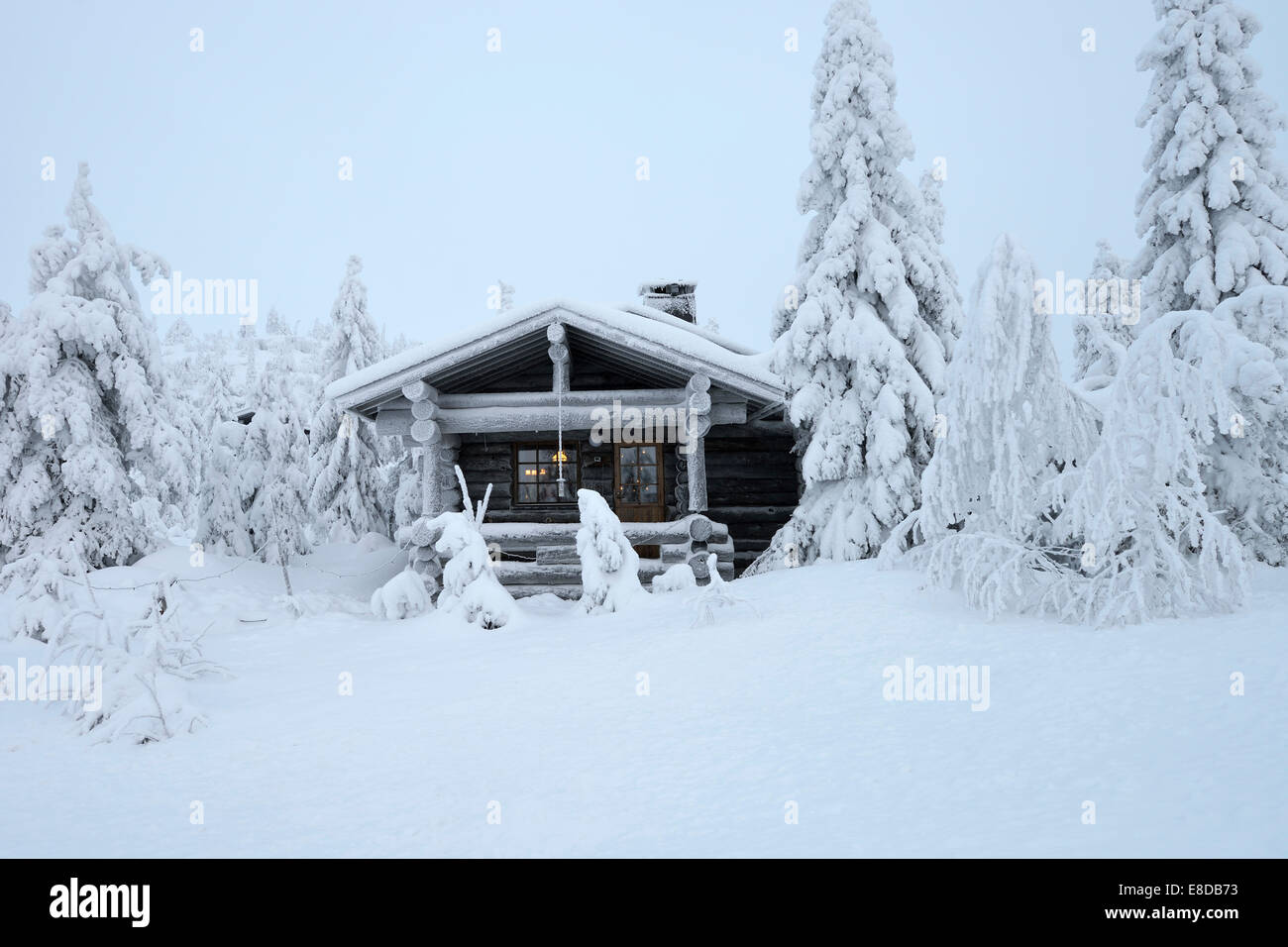 Finnish log cabin in the snow-covered landscape, Iso Syöte, Lapland, Finland Stock Photo
