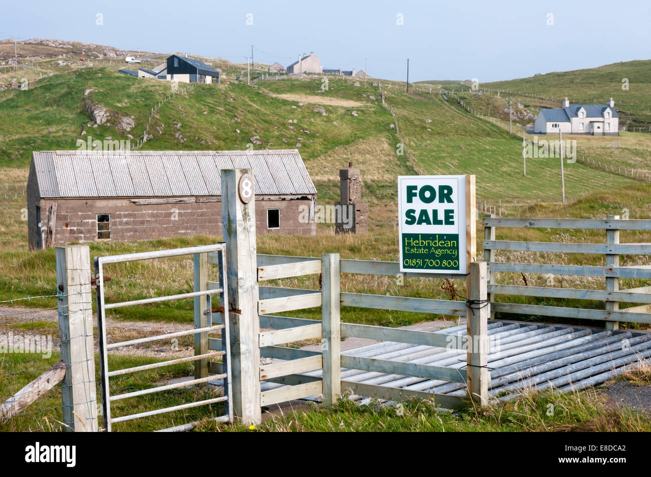 A For Sale sign on land in the Outer Hebrides. - Stock Image