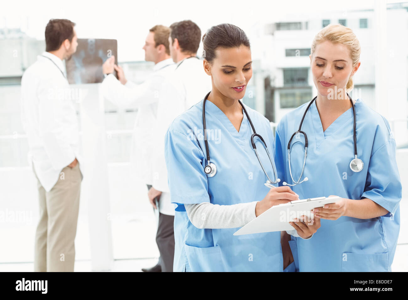 Two female surgeons looking at reports - Stock Image