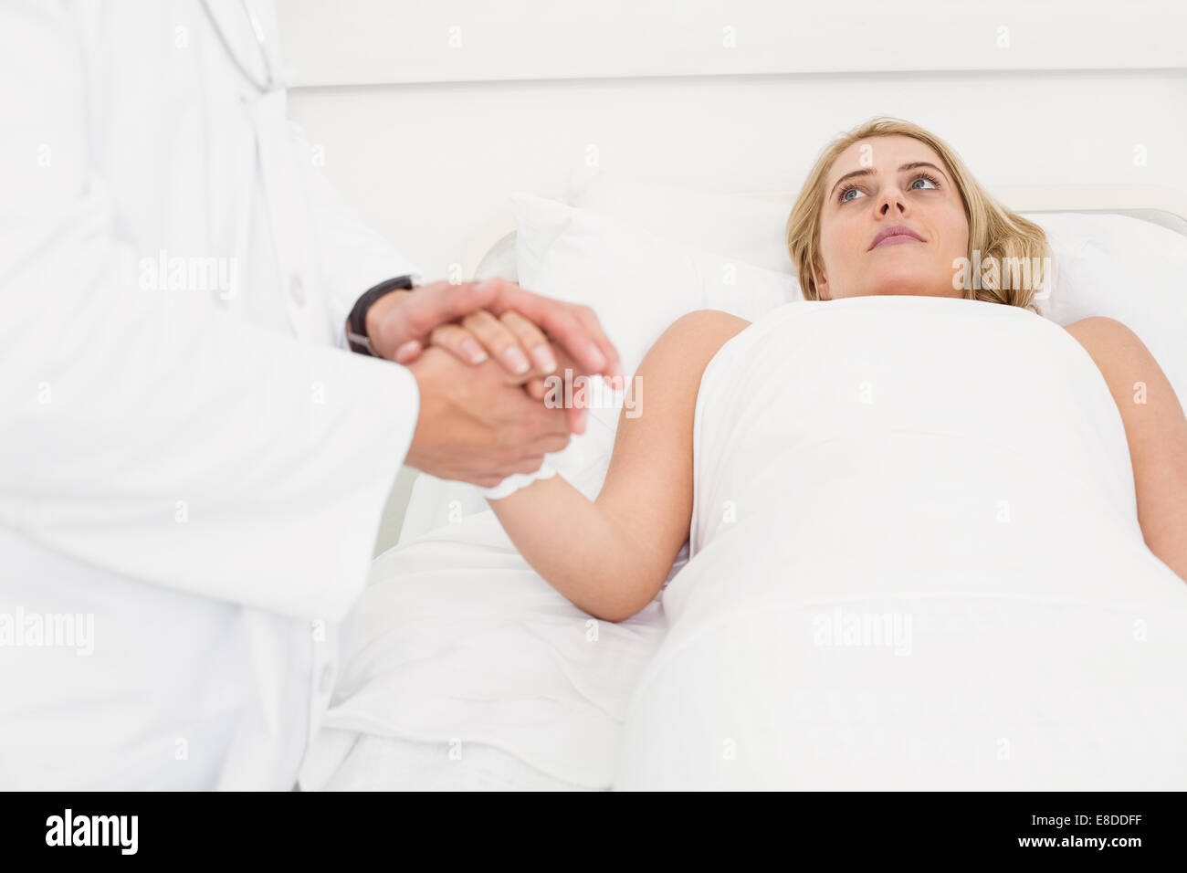 Doctor visiting patient in hospital Stock Photo