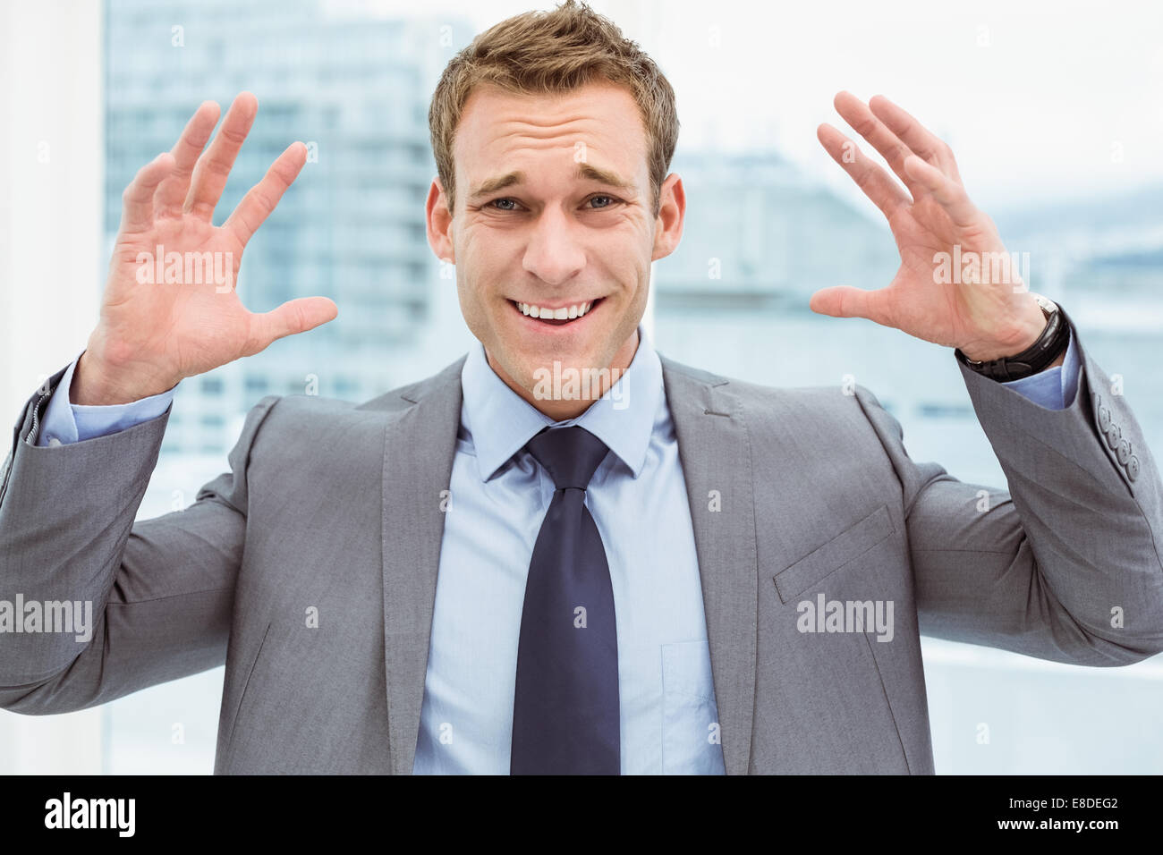 Angry young businessman at office - Stock Image