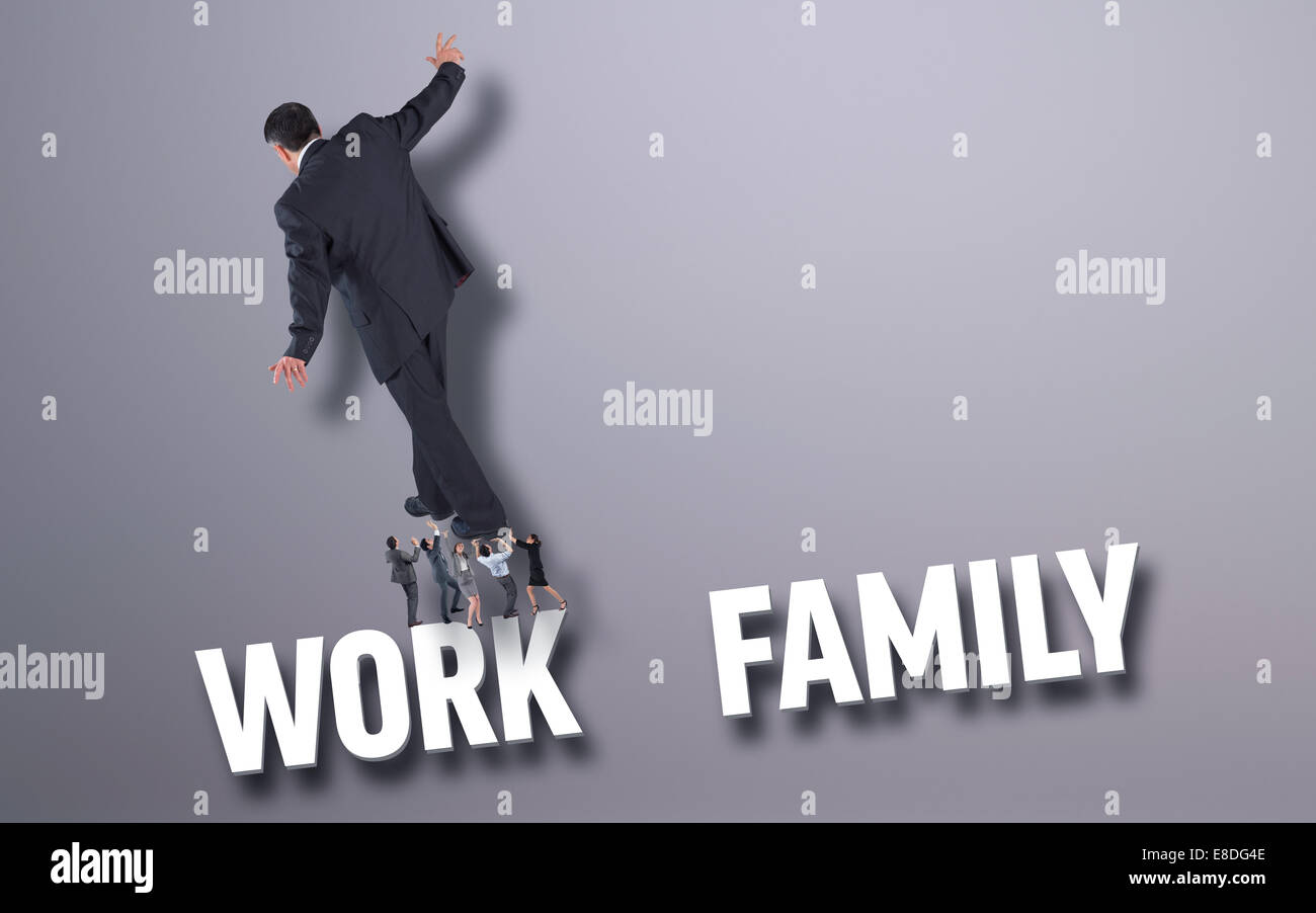 Composite image of business people supporting boss - Stock Image